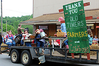 MEGAN DAVIS/MCDONALD COUNTY PRESS The Cornerstone 4-H float for the Old Timer's Day parade featured club members in old time dress with a special thank you to old timers, farmers and cowboys.