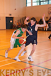 Bouncing Back: Diarmuid Herlihy (St Brendans) controls the ball as Mark Winn (Queens) claims no foul in last weekend's u18 basketball championships at Mounthawk Gym, Tralee.