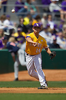 LSU Tigers third baseman Christian Ibarra #14 makes a throw to first base against the Auburn Tigers in the NCAA baseball game on March 24, 2013 at Alex Box Stadium in Baton Rouge, Louisiana. LSU defeated Auburn 5-1. (Andrew Woolley/Four Seam Images).