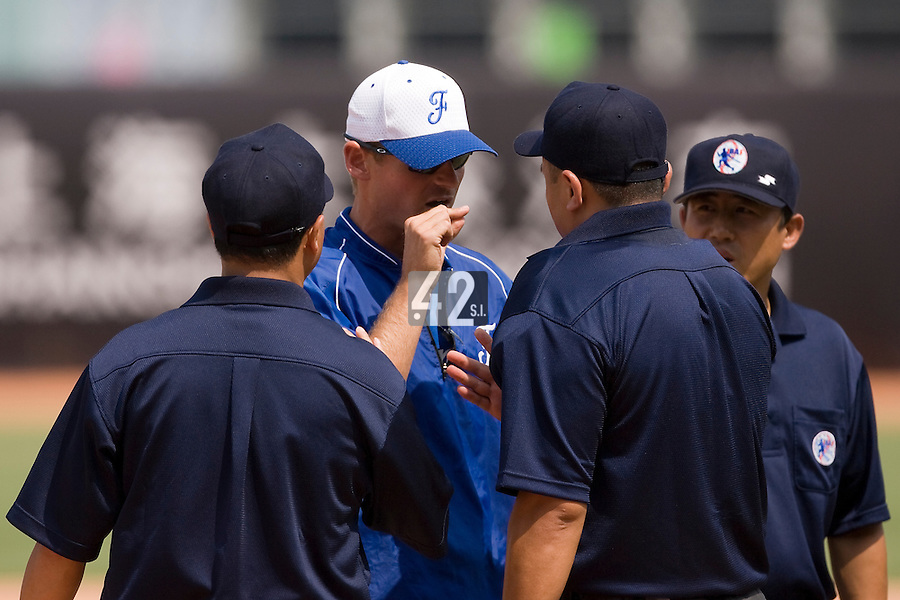 23 August 2007: France Team Manager Jeff Zeilstra argues with the home plate umpire during the France 8-4 victory over Czech Republic in the Good Luck Beijing International baseball tournament (olympic test event) at the Wukesong Baseball Field in Beijing, China.