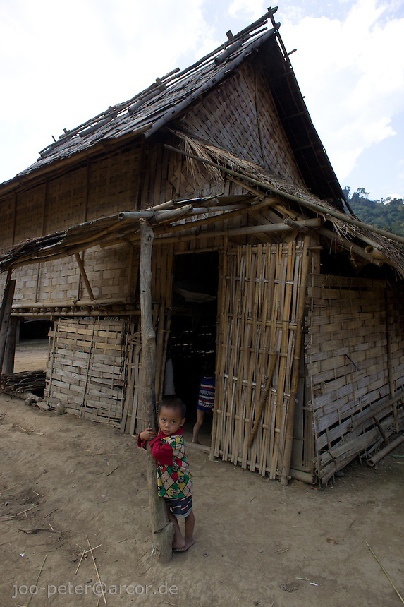 boy in front of a farm house in a small village close to Luang Prabang, Laos, 2012