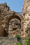 An arched entryway into the Roman theater in the ruins of Caesarea Maritima at Caesarea National Park in Israel.  The city was built as a port on the Mediterranean Sea by Herod the Great between 22 and 15 B.C.