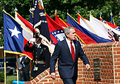 United States President George W. Bush arrives to participate in an Armed Forces Change of Command ceremony and official Hail and Farewell tribute in honor for out-going Chairman of the Joint Chiefs of Staff. US Marine Corps General Peter Pace and in-coming Chairman of the Joint Chiefs of Staff US Navy Admiral Michael Mullen at Fort Myer, Virginia on October 1, 2007.<br /> Credit: Aude Guerrucci / Pool via CNP