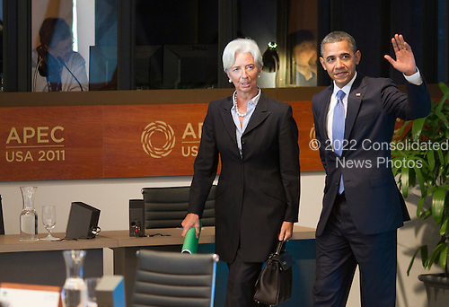 United States President Barack Obama walks with International Monetary Fund Chief Christine Lagarde at the Opening plenary session of the Asia-Pacific Economic Cooperation (APEC) summit at the J.W. Marriott Hotel in Honolulu, Hawaii on Sunday, November 13, 2011..Credit: Kent Nishimura / Pool via CNP