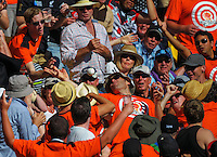A fan catches one of Brendon McCullum's sixes during the ICC Cricket World Cup one day pool match between the New Zealand Black Caps and England at Wellington Regional Stadium, Wellington, New Zealand on Friday, 20 February 2015. Photo: Dave Lintott / lintottphoto.co.nz