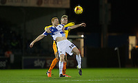 Rory Gaffney of Bristol Rovers holds off Jason McCarthy of Wycombe Wanderers during the Sky Bet League 2 rearranged match between Bristol Rovers and Wycombe Wanderers at the Memorial Stadium, Bristol, England on 1 December 2015. Photo by Andy Rowland.