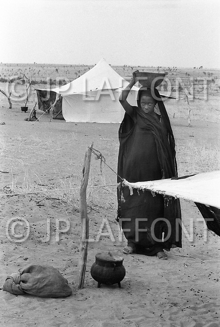Children born into slavery work all day lond in cooking in the are of Boutlimit, Mauritania - Child labor as seen around the world between 1979 and 1980 – Photographer Jean Pierre Laffont, touched by the suffering of child workers, chronicled their plight in 12 countries over the course of one year.  Laffont was awarded The World Press Award and Madeline Ross Award among many others for his work.