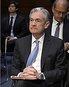 Jerome H. Powell listens to the business part of the meeting prior to giving testimony before the United States Senate Committee on Banking, Housing, and Urban Affairs on his nomination to be Chairman of the Board of Governors of the Federal Reserve System on Capitol Hill in Washington, DC on Tuesday, November 28, 2017.<br /> Credit: Ron Sachs / CNP