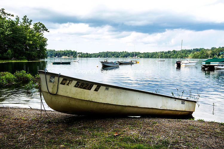 Middlebury, CT- 28 July 2017-072817CM03-   CL Banners A boat is docked on shores of Lake Quassy in Middlebury.      Christopher Massa Republican-American