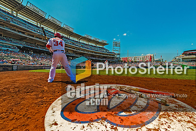 25 July 2013: Washington Nationals outfielder Bryce Harper stands on deck during a game against the Pittsburgh Pirates at Nationals Park in Washington, DC. The Nationals salvaged the last game of their series, winning 9-7 ending their 6-game losing streak. Mandatory Credit: Ed Wolfstein Photo *** RAW (NEF) Image File Available ***