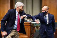 """United States Senator Bill Cassidy (Republican of Louisiana), left, elbow bumps US Secretary of Labor Eugene Scalia before the start of a US Senate Finance Committee hearing on """"COVID-19/Unemployment Insurance"""" on Capitol Hill in Washington on Tuesday, June 9, 2020.<br /> Credit: Caroline Brehman / Pool via CNP/AdMedia"""