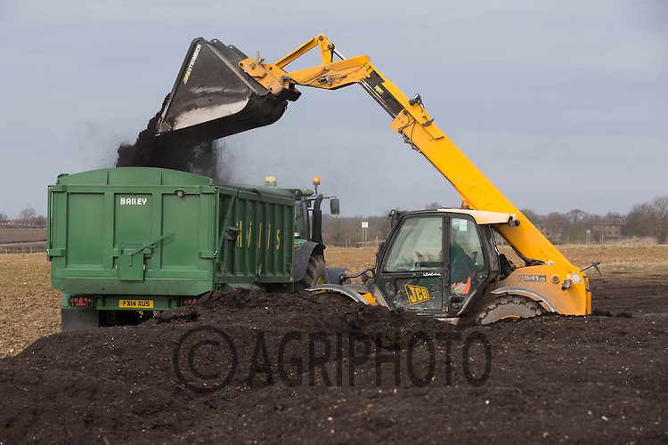 Carting recycled garden waste that has been made into compost for use on arable land<br /> Picture Tim Scrivener 07850 303986
