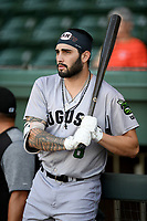 Left fielder Francisco Tostado (8) of the Augusta GreenJackets in the on deck circle before a game against the Greenville Drive on Thursday, August 29, 2019, at Fluor Field at the West End in Greenville, South Carolina. Augusta won, 11-0. (Tom Priddy/Four Seam Images)