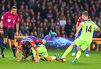 Philippe Coutinho of Liverpool and James McArthur of Crystal Palace tangle as Jordan Henderson collects the ball  during the EPL - Premier League match between Crystal Palace and Liverpool at Selhurst Park, London, England on 29 October 2016. Photo by Steve McCarthy.