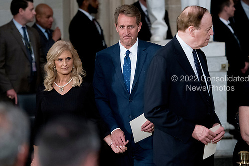 Sen. Jeff Flake, R-Ariz., center, and his wife Cheryl Flake, left, arrive in the Rotunda before the casket of Sen. John McCain, R-Ariz., lies in state at the U.S. Capitol, Friday, Aug. 31, 2018, in Washington. Also pictured is Sen. Richard Shelby, R-Ala., right. (AP Photo/Andrew Harnik, Pool)
