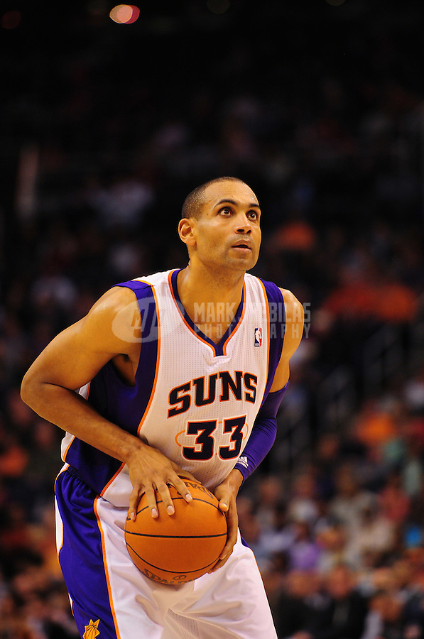 Dec. 28, 2011; Phoenix, AZ, USA; Phoenix Suns forward Grant Hill prepares to take a shot during game against the Philadelphia 76ers at the US Airways Center. The 76ers defeated the Suns 103-83. Mandatory Credit: Mark J. Rebilas-USA TODAY Sports
