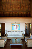 FRENCH POLYNESIA, Moorea Island. Bungalows, Interiors and views of the Legends Resort Moorea. View of a living room of one of the bungalows.