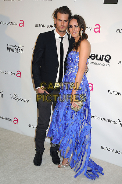 guest & Louise Roe.21st Annual Elton John Academy Awards Viewing Party held at West Hollywood Park, West Hollywood, California, USA..February 24th, 2013.oscars full length black suit blue dress strapless streamers  .CAP/ADM/BP.©Byron Purvis/AdMedia/Capital Pictures.