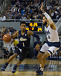Akron guard  Loren Cristian Jackson (1) drives past Nevada's Cody Martin (11) in the second half of an NCAA college basketball game in Reno, Nev., Saturday, Dec. 22, 2018. (AP Photo/Tom R. Smedes)