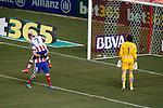 Atletico de Madrid's Antoine Griezmann celebrates goal in presence of UD Almeria's Julian Cuesta during La Liga match.February 21,2015. (ALTERPHOTOS/Acero)
