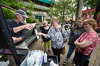 NWA Democrat-Gazette/BEN GOFF @NWABENGOFF<br /> Randy Woodward (from left) of The SandCastle Silica & Glass in Eureka Springs shows Sharon Vreeman, Dianne Perry, Sophie Seure, and Janell Kraut, all visiting from Minnesota, how to make silica and glass art Tuesday, May 14, 2019, at Basin Spring Park in Eureka Springs. Woodward is a regular at the park with his participatory art making.