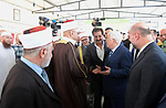 Palestinian President Mahmoud Abbas inspects City of pilgrims, in the West Bank of Jericho, on Aug. 06, 2018. Photo by Thaer Ganaim