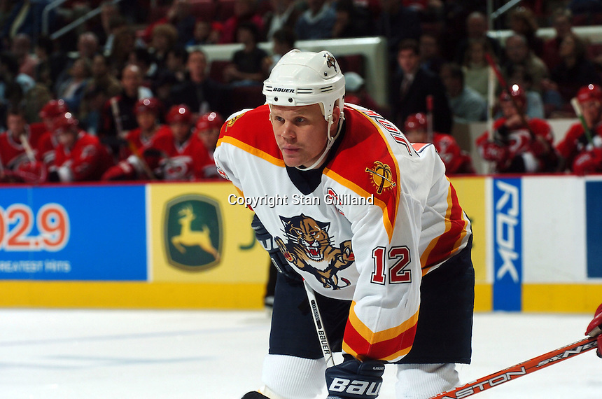 Florida Panthers' Olli Jokinen of Finland watches a faceoff against the Carolina Hurricanes Friday, Dec. 23, 2005 in Raleigh, NC. Carolina won 4-3.