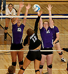 SIOUX FALLS, SD - SEPTEMBER 25: Anne McCabe #12 and Meredith Lammers #17 from Dakota Valley try for a block on Paige DeJong #12 from Sioux Falls Christian in the second game of their match Thursday night at Sioux Falls Christian High.  (Photo by Dave Eggen/Inertia)
