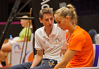 April 15, 2015, Netherlands, Den Bosch, Maaspoort, Fedcup Netherlands-Australia, Training session Dutch team, Arantxa Rus and Captain Paul Haarhuis and in the background Kiki Bertens<br /> Photo: Tennisimages/Henk Koster