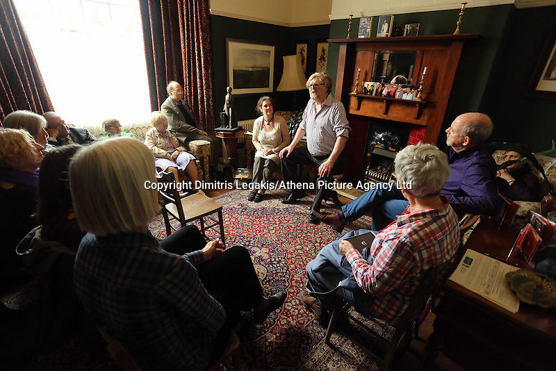 Swansea, UK. Saturday 25 October 2014<br /> Pictured: Welsh writer, actor, singer and musician Boyd Clark with Kirsten Jones with an audience in the front room of Dylan Thomas' birthplace.<br /> Re: Dylan Thomas birthday centenary celebrations at his birthplace, 5 Cwmdonkin Drive, Swansea, south Wales.