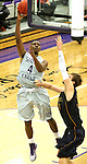 SIOUX FALLS, SD - JANUARY 2:  Kebu Johnson #4 from the University of Sioux Falls shoots a short hook shot over Zach Huisken #33 from Augustana in the second half of their game Friday night at the Stewart Center. (Photo by Dave Eggen/Inertia)