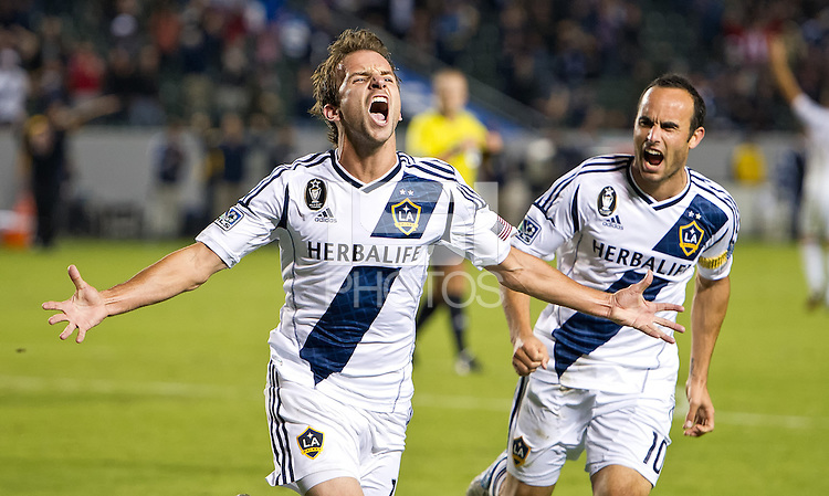CARSON, CA - November 1, 2012: LA Galaxy midfielders Landon Donovan (10) and Mike Magee (18) celebrates his goal during the LA Galaxy vs the Vancouver Whitecaps FC at the Home Depot Center in Carson, California. Final score LA Galaxy 2, Vancouver Whitecaps FC 1.