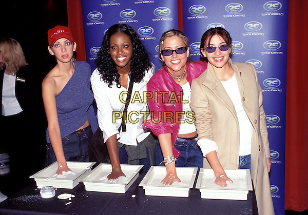 ALL SAINTS .NATALIE APPLETON, SHAZNAY LEWIS, NICOLE APPLETON, MELANIE BLATT.plaster hands, girl band.Ref: 8899/2809h.www.capitalpictures.com.sales@capitalpictures.com.© Capital Pictures