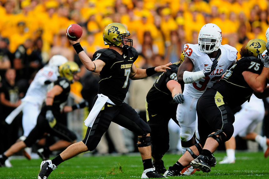 04 October 2008: Colorado quarterback Cody Hawkins passes against Texas. Pressuring Hawkins is Texas defensive tackle Lamarr Houston (33). The Texas Longhorns defeated the Colorado Buffaloes 38-14 at Folsom Field in Boulder, Colorado. For Editorial Use Only