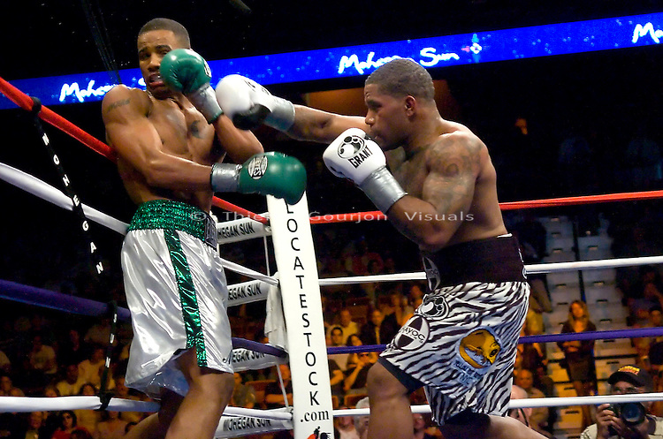 Uncasville, CT:  (r-l) Curtis Stevens lands on  Andre Dirrell during their 10 rounds Super Middleweight fight at the Mohegan Sun Casino, June 16th, 2007. Dirrell won  by unanimous decision..