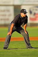 Umpire Charlie Ramos handles the calls on the bases during the Pioneer League game between the Orem Owlz and the Ogden Raptors at Lindquist Field on July 27, 2012 in Ogden, Utah.  The Raptors defeated the Owlz 6-3.   (Brian Westerholt/Four Seam Images)