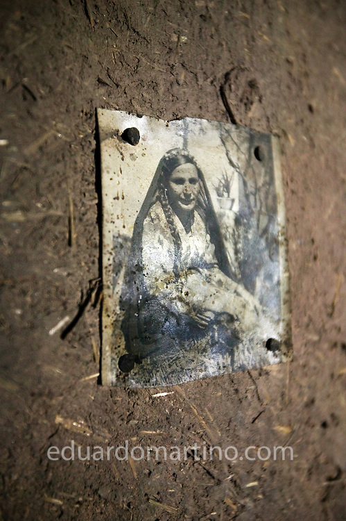 An old picture of Zeinab hanging on the wall of the tomb where she lives..Qurna, Luxor, Egypt..Photo: Eduardo Martino