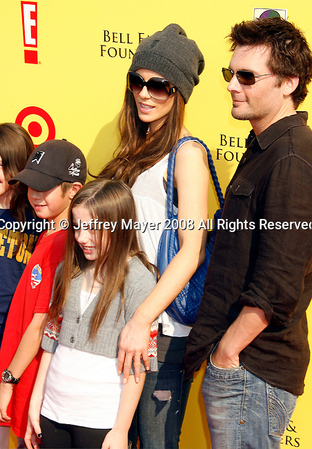 "SANTA MONICA, CA. - November 16: Actress Kate Beckinsale, Director Len Wiseman and children arrive at the 11th Anniversary Of P.S. Arts ""Express Yourself 2008"" at the Barker Hanger at the Santa Monica Airport on November 16, 2008 in Santa Monica, California."