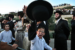Ultra Orthodox Jews demonstrate against the Jerusalem's municipality's decision to open one of the parking lots in the city on Sabbath, Jerusalem, July 11, 2009. This is the third week in a row in which the Ultra-Orthodox Jews of Jerusalem have flocked in their thousands to the streets and continue clashes with police and members of the press. Photo By : Maya Levin / JINI