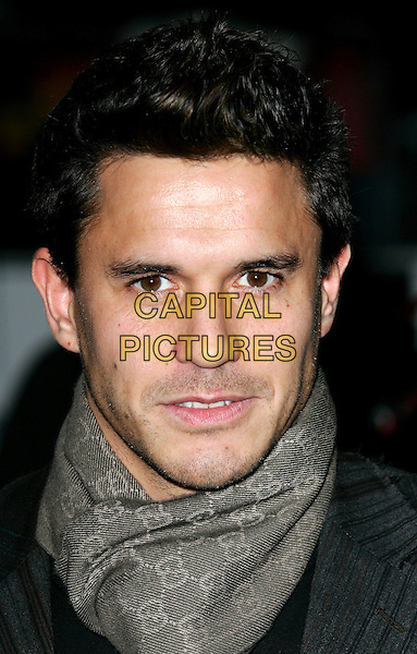 "JEREMY EDWARDS.Premiere of ""After The Sunset"", Vue Cinema, Leicester Square, London.November 2nd, 2004.headshot portrait scarf stubble.www.capitalpictures.com.sales@capitalpictures.com.©Capital Pictures."