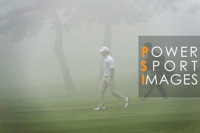 JEJU, SOUTH KOREA - APRIL 21:  Pablo Larrazabal (L) and his caddie and brother Alejandro Larrazabal of Spain walk through the fog during the pro - am of the Ballantine's Championship at Pinx Golf Club on April 21, 2010 in Jeju island, South Korea. Photo by Victor Fraile / The Power of Sport Images