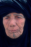 Marsh Arabs. Southern Iraq. Circa 1985. Old woman with tribal tattooed face. Haur al Mamar or Haur al-Hamar marsh collectively known now as Hammar marshes Irag 1984