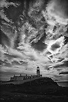 Changing light over Neist Point lighthouse, Scotland.  Large, cloudy sky