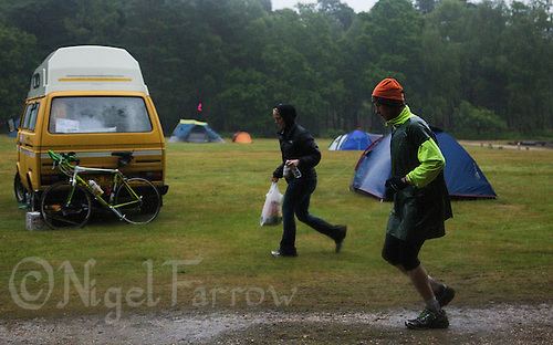 12 JUN 2011 - BRANSGORE, GBR - Gerry Duffy runs past the race campsite as he completes the last few miles on day 10 of the Deca Enduroman at the Enduroman Ultra Triathlon Championships .(PHOTO (C) NIGEL FARROW)
