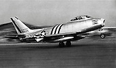 The F-86, the United States Air Force's first swept-wing jet fighter, made its initial flight on October 1, 1947. The first production model flew on May 20, 1948, and on September 15, 1948, an F-86A set a new world speed record of 670.9 mph. Originally designed as a high-altitude day-fighter, it was subsequently redesigned into an all-weather interceptor (F-86D) and a fighter-bomber (F-86H).   As a day fighter, the airplane saw service in Korea in three successive series (F-86A, E, and F) where it engaged the Russian-built MiG-15. By the end of hostilities, it had shot down 792 MiGs at a loss of only 76 Sabres, a victory ratio of 10 to 1.  More than 5,500 Sabre day-fighters were built in the United States and Canada. The airplane was also used by the air forces of 20 other nations, including West Germany, Japan, Spain, Britain, and Australia..Credit: U.S. Air Force via CNP