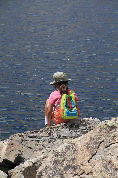 Young girl sitting at lake, Boulder, Colorado, USA. .  John leads private photo tours in Boulder and throughout Colorado. Year-round.