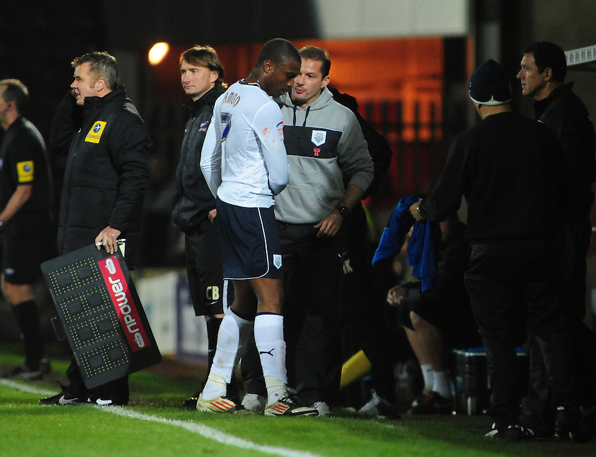 Preston North End's David Amoo shakes hands with Preston North End's Manager Graham Westley after the second half substitute was substituted himself in injury time..Football - npower Football League Division One - Scunthorpe United v Preston North End - Tuesday 23rd October 2012 - Glanford Park - Scunthorpe..