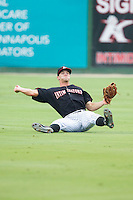 Kannapolis Intimidators center fielder Adam Engel (23) makes a throw to third base from his backside after a sliding attempt at catching a line drive against the Lakewood BlueClaws at CMC-NorthEast Stadium on July 20, 2014 in Kannapolis, North Carolina.  The Intimidators defeated the BlueClaws 7-6. (Brian Westerholt/Four Seam Images)