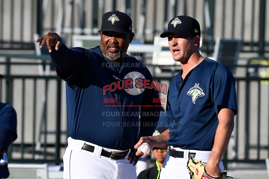 Starting pitcher Gary Cornish (23), right, of the Columbia Fireflies listens to pitching coach Jonathan Hurst in a game against the Lexington Legends on Thursday, June 8, 2017, at Spirit Communications Park in Columbia, South Carolina. Columbia won, 8-0. (Tom Priddy/Four Seam Images)