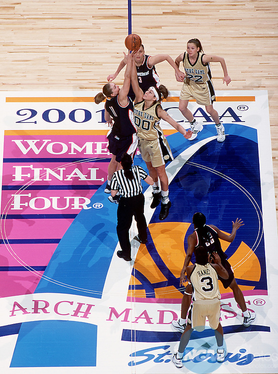 30 MAR 2001:  Center Ruth Riley (00) of Notre Dame and center Kelly Schumacher (11) of the University of Connecticut sky for the jump ball to start the game during the Division 1 Women's Basketball Semifinals held at the Savvis Center in St. Louis, MO.  Notre Dame defeated UCONN 90-75 to advance to the national championship game.  Jamie Schwaberow/NCAA Photos